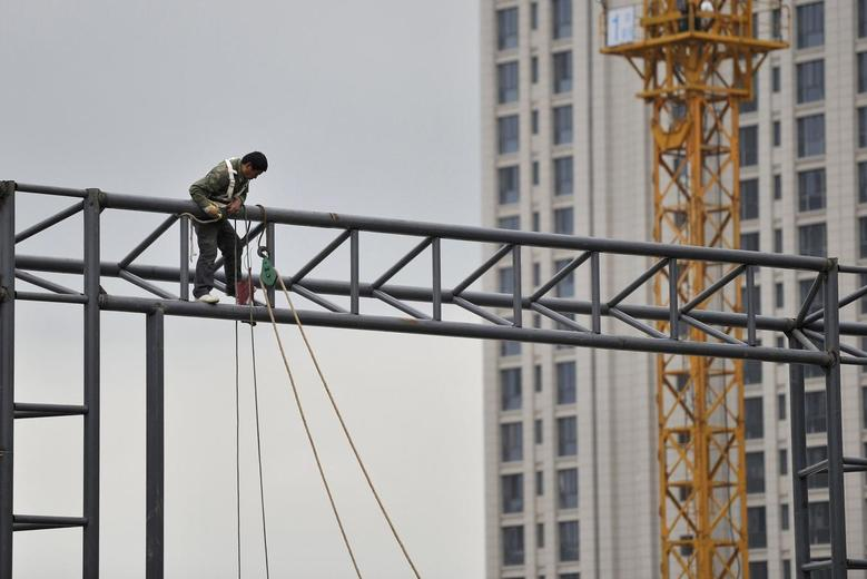A labourer works at a construction site in Hefei, Anhui province, April 15, 2014. REUTERS/Stringer