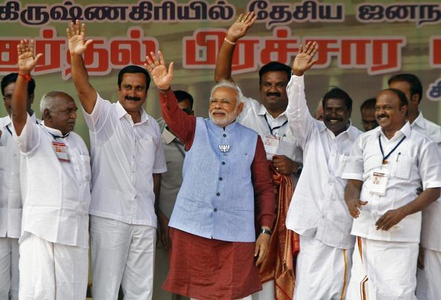 Hindu nationalist Narendra Modi (C), the prime ministerial candidate for India's main opposition Bharatiya Janata Party (BJP) and Gujarat's chief minister, waves to his supporters during a public meeting at Krishnagiri in the southern Indian state of Tamil Nadu April 16, 2014. REUTERS/Babu