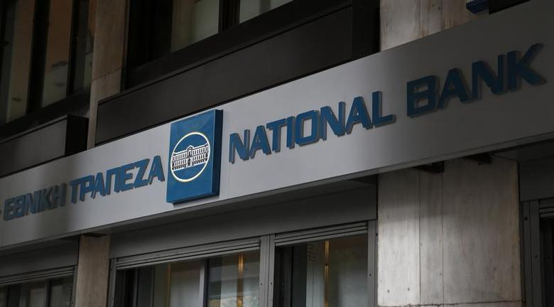 The logo of National Bank is seen outside a branch in Athens December 31, 2013. REUTERS/Yorgos Karahalis