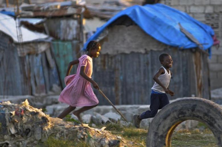 Children play in a slum area in Port-au-Prince December 17, 2012. REUTERS/Swoan Parker