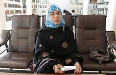 Serena Faizi, 25, one of the provincial candidate elections from Kandahar, sits at a public library in Kandahar province, April 14, 2014. REUTERS/ Ahmad Nadeem
