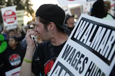A man chants outside Wal-Mart during a protest for better wages and working conditions during Black Friday in San Leandro, California November 29, 2013. REUTERS/Stephen Lam
