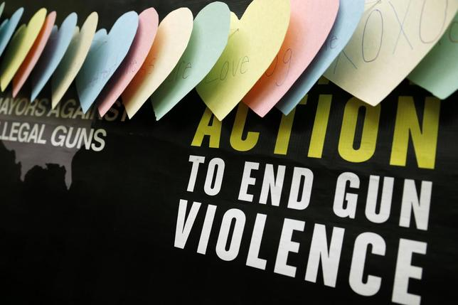 A backdrop is pictured during a news conference held by groups Mayors Against Illegal Guns and Moms Demand Action for Gun Sense in America, on Capitol Hill in Washington, February 12, 2014. REUTERS/Jonathan Ernst
