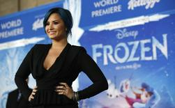 "Singer Demi Lovato, who is featured on the soundtrack, poses at the premiere of ""Frozen"" at El Capitan theatre in Hollywood, California November 19, 2013. REUTERS/Mario Anzuoni"