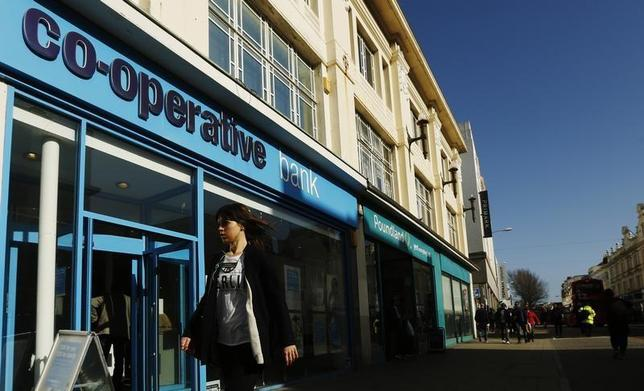 A woman passes a Co-operative Bank in Brighton, southern England February 26, 2014. REUTERS/Luke MacGregor