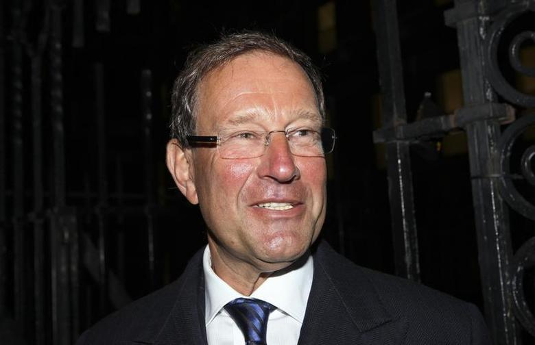 Express newspapers owner Richard Desmond smiles as he leaves after giving evidence to the Leveson Inquiry at the High Court in London January 12, 2012. REUTERS/Olivia Harris