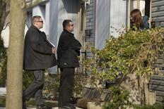 """Royal Canadian Mounted Police (RCMP) investigators canvas the London, Ontario neighbourhood April 16, 2014, around the home of Stephen Solis-Reyes who has been charged in connection with exploiting the """"Heartbleed"""" bug to steal taxpayer data from a government website. REUTERS/Geoff Robins"""