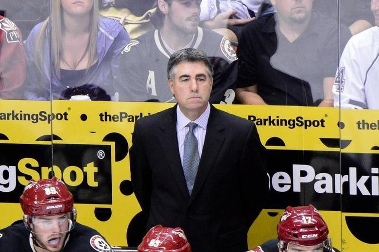 Oct 22, 2013; Glendale, AZ, USA; Phoenix Coyotes head coach Dave Tippett looks on during the third period against the Calgary Flames at Jobing.com Arena. Matt Kartozian-USA TODAY Sports