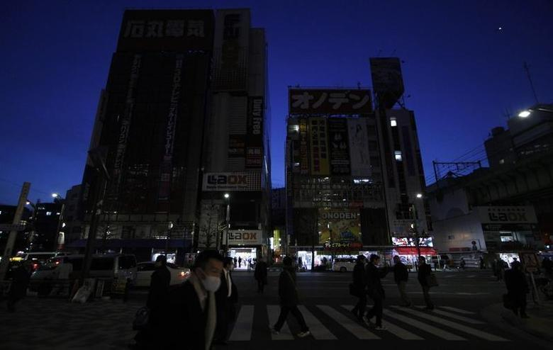 Neon signs on electronics shops are tuned off to save energy in Tokyo's Akihabara district March 18, 2011. REUTERS/Toru Hanai