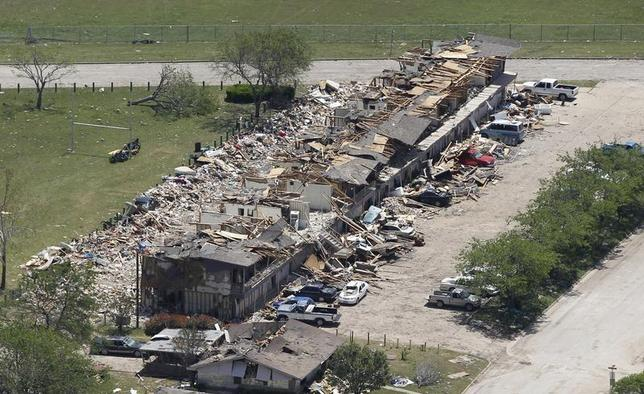 A block of residences is pictured near the site of a fertilizer plant explosion in West, Texas, pictured from the air as U.S. President Barack Obama and First Lady Michelle Obama (not pictured) assess the damage from Marine One April 25, 2013, on their way to a memorial service for the victims who died, at Baylor University in Waco. REUTERS/Jason Reed
