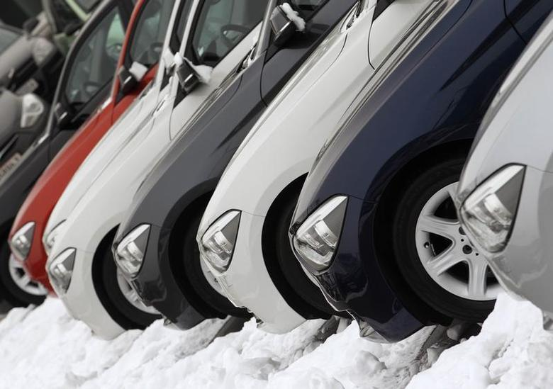 Cars for sale stand in a sales lot at a dealer in Vienna January 16, 2013. REUTERS/Heinz-Peter Bader