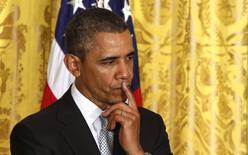 Президент США Барак Обама во время церемонии в Белом доме в Вашингтоне 3 апреля 2014 года. Новые американские санкции, наказывающие Россию за ее действия на Украине, вероятно, будут объявлены уже в пятницу, если на встрече министров иностранных дел в Женеве не будет достигнут ощутимый прогресс. REUTERS/Larry Downing