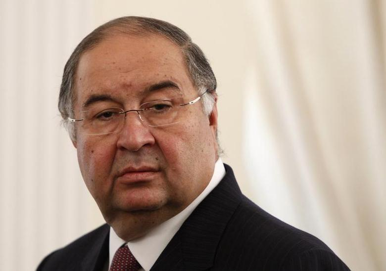 Uzbek-born Russian businessman Alisher Usmanov attends a meeting between Russian President Vladimir Putin and Crown Prince of Abu Dhabi Sheikh Mohammed bin Zayed al-Nahyan at the Novo-Ogaryovo state residence, outside Moscow September 12, 2013. REUTERS/Maxim Shemetov