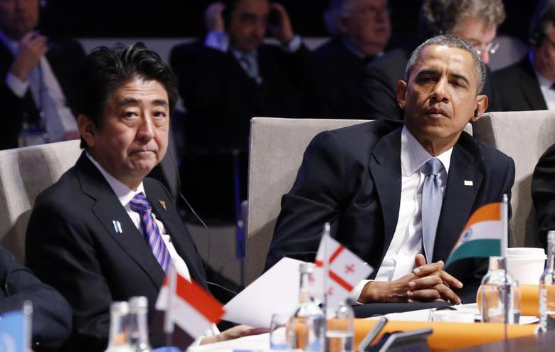 U.S. President Barack Obama (R) and Japan's Prime Minister Shinzo Abe attend the opening session of the Nuclear Security summit (NSS) in The Hague March 24, 2014. REUTERS/Yves Herman