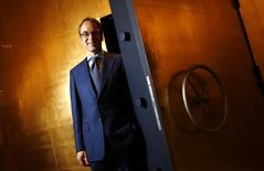 File photo of Germany's federal reserve Bundesbank President Jens Weidmann posing for a photo beside the door of a giant safe at the money museum next to the Bundesbank headquarters in Frankfurt May 17, 2013. REUTERS/Kai Pfaffenbach/Files