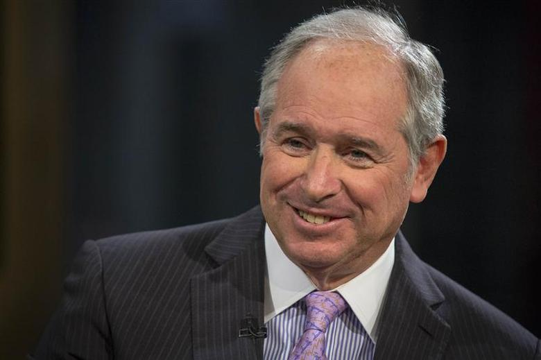 Stephen A. Schwarzman, Chairman and Chief Executive Officer of The Blackstone Group, speaks during a television interview in New York in this February 27, 2014, file photo. REUTERS/Brendan McDermid/Files