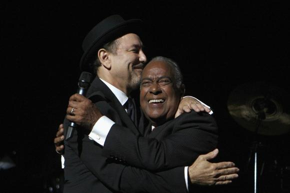 Puerto Rican salsa singer Jose ''Cheo'' Feliciano (R) embraces Panamanian singer Ruben Blades during Blades' initial concert of his new tour ''Todos Vuelven'' at the Puerto Rico Coliseum in San Juan, in this August 21, 2009 file photo. REUTERS/Ana Martinez/Files