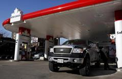 A man pumps gas into his truck at a Petro-Canada gas station in Toronto January 31, 2008. REUTERS/Mark Blinch