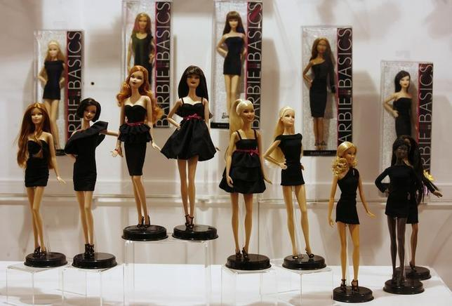 Barbie dolls are displayed inside a showroom at a Mattel office in Hong Kong January 12, 2010. REUTERS/Bobby Yip