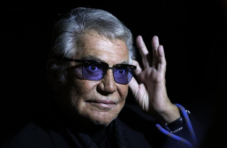 Italian designer Roberto Cavalli acknowledges the audience at the end of his Spring/Summer 2014 collection during Milan Fashion Week September 21, 2013. REUTERS/Max Rossi