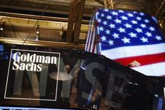 The Goldman Sachs logo is displayed on a post above the floor of the New York Stock Exchange in this file photo taken September 11, 2013. REUTERS/Lucas Jackson/Files