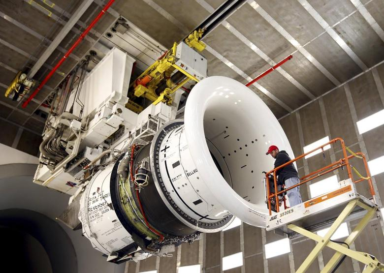 General Electric employee Brian Kirk prepares a GEnx-747 jet engine at the GE Aviation Peebles Test Operations Facility in Peebles, Ohio in this file photo taken November 15, 2013. REUTERS/Matt Sullivan/Files