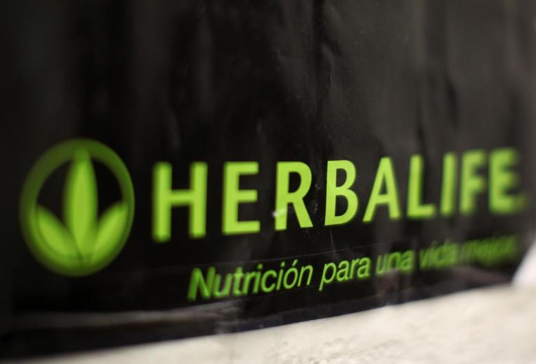 An Herbalife logo is shown on a poster at a clinic in the Mission District in San Francisco, California April 29, 2013. REUTERS/Robert Galbraith