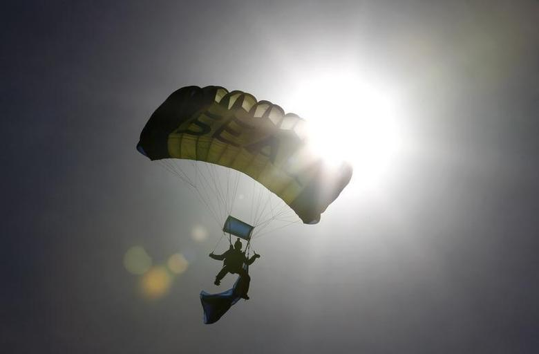 A Navy SEAL takes part in a demonstration in Florida November 11, 2011. REUTERS/Joe Skipper