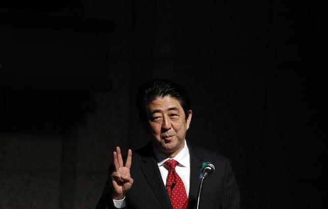 Japan's Prime Minister Shinzo Abe gestures as he gives a keynote address at Japan Summit 2014 hosted by the Economist magazine in Tokyo April 17, 2014. REUTERS/Yuya Shino