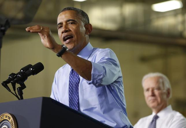 U.S. President Barack Obama speaks next to U.S. Vice President Joseph Biden after touring the Community College of Allegheny West Hills Center in Oakdale, Pennsylvania, April 16, 2014. REUTERS/Larry Downing