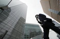 A businessman walks in Tokyo's business district April 18, 2014. REUTERS/Toru Hanai