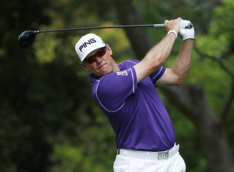 Britain's Lee Westwood hits his tee shot on the second hole during the final round of the Masters golf tournament at the Augusta National Golf Club in Augusta, Georgia April 13, 2014. REUTERS/Mike Blake