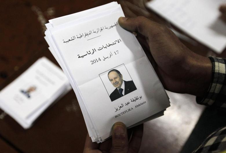 An election official holds a ballot paper of Algeria's President Abdelaziz Bouteflika during the vote counting process at a polling station in Algiers April 17, 2014. REUTERS/Louafi Larbi