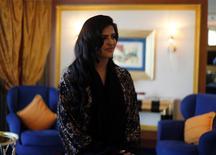 Princess Ameerah al-Taweel, chief executive of Saudi-based Time Entertainment Holding, stands in Burj Al Arab hotel in Dubai March 9, 2014. REUTERS/Ahmed Jadallah