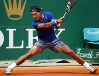 Rafael Nadal of Spain returns the ball to his compatriot David Ferrer during their quarter-final match at the Monte Carlo Masters in Monaco April 18, 2014. REUTERS/Eric Gaillard