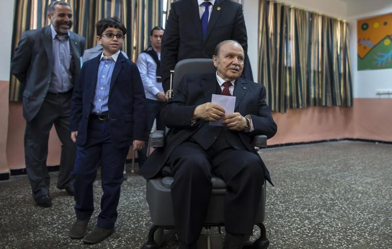 Algeria's President Abdelaziz Bouteflika (seated) holds his ballot during the presidential election in Algiers April 17, 2014. REUTERS/Zohra Bensemra