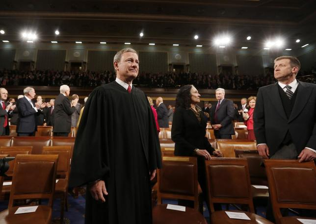 U.S. Supreme Court Chief Justice John Roberts arrives prior to President Barack Obama's State of the Union speech on Capitol Hill in Washington, January 28, 2014. REUTERS/Larry Downing