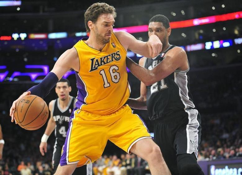 March 19, 2014; Los Angeles, CA, USA; Los Angeles Lakers center Pau Gasol (16) moves to the basket against the San Antonio Spurs during the first half at Staples Center. Mandatory Credit: Gary A. Vasquez-USA TODAY Sports - RTR3HTNR
