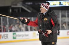 Feb 28, 2014; Chicago, IL, USA; Chicago Blackhawks head coach Joel Quenneville during practice the day before a Stadium Series hockey game against the Pittsburgh Penguins at Soldier Field. Mandatory Credit: Rob Grabowski-USA TODAY Sports - RTR3FUDA