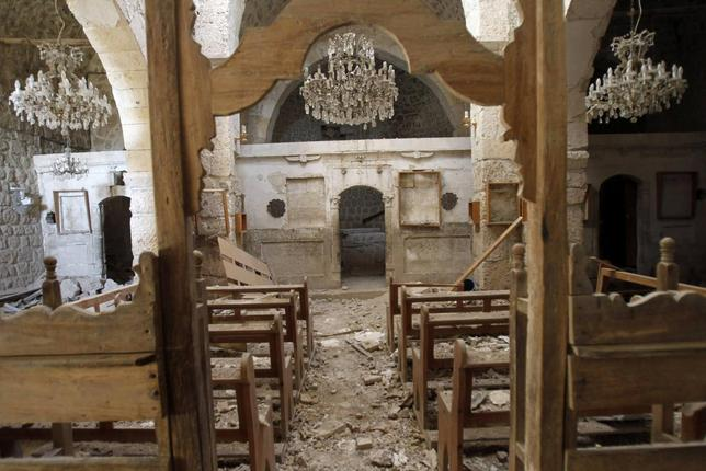 Debris lie inside a damaged church in Mar Bacchus Sarkis monastery, in Maloula village, northeast of Damascus, after soldiers loyal to Syria's President Bashar al-Assad took control of it from rebel fighters, April 14, 2014. REUTERS/Khaled al-Hariri