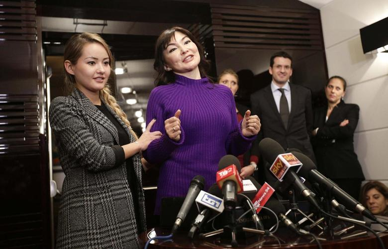 Alma Shalabayeva (R), the wife of exiled oligarch Mukhtar Ablyazov, talks next to her daughter Madina during a news conference in Rome December 27, 2013. REUTERS/Max Rossi