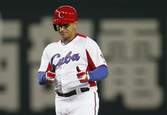 Cuba's Frederich Cepeda reacts after hitting an RBI double against Japan in the fourth inning at the World Baseball Classic (WBC) qualifying first round in Fukuoka, southern Japan March 6, 2013. REUTERS/Toru Hanai