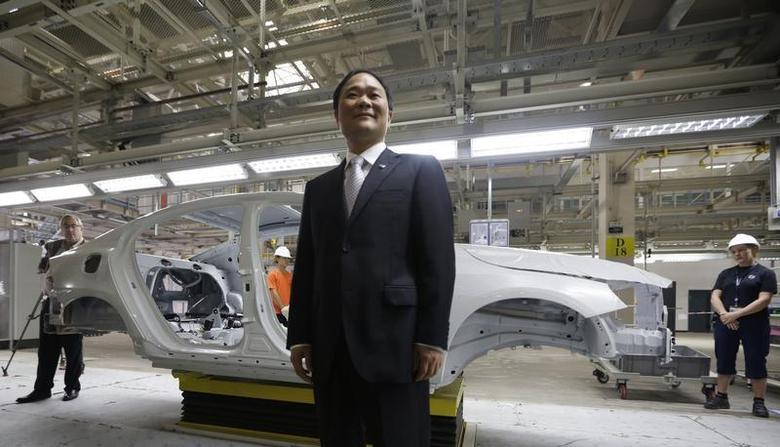 Chairman of Zhejiang Geely Holding Group Li Shufu poses for a photo at an assembly line of the new Volvo automobile manufacturing plant in Chengdu, Sichuan province, June 5, 2013. REUTERS/Jason Lee