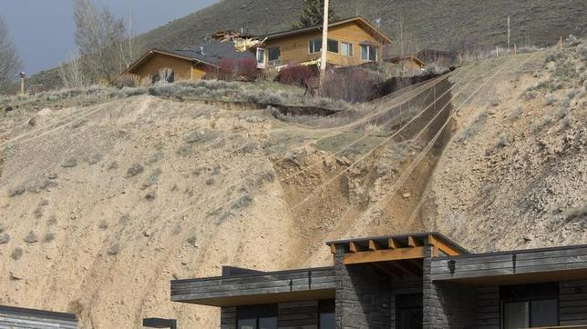 A ridge top home is split in pieces as a slow-moving landslide threatens several houses and businesses in Jackson Hole, Wyoming April 18, 2014. REUTERS/David Stubbs