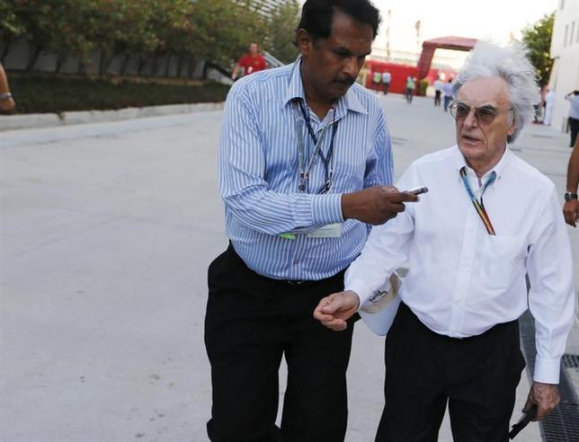 Formula One commercial supremo Bernie Ecclestone's hair blows in the wind while being interviewed as he walks at the paddock after the third practice session of the Bahrain F1 Grand Prix at the Bahrain International Circuit (BIC) in Sakhir, south of Manama April 5, 2014. REUTERS/Hamad I Mohammed