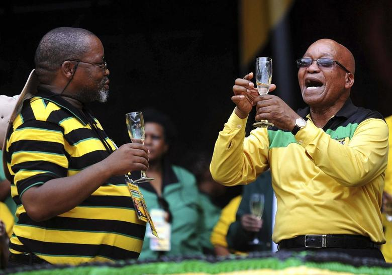 South Africa's president and leader of the ruling African National Congress (ANC) party Jacob Zuma raises his glass next to ANC Secretary General Gwede Mantashe (L) during the party's 102nd anniversary celebration, where they also launched their election manifesto, at Mbombela stadium in Nelspruit January 11, 2014. REUTERS/Ihsaan Haffejee