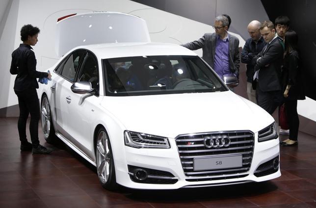 Visitors look at an Audi S8 car at Auto China 2014 in Beijing April 20, 2014. REUTERS/Jason Lee