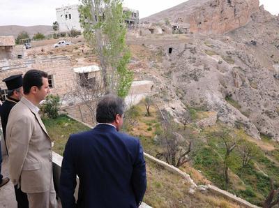 Syria's Assad pays Easter visit to recaptured Christia...