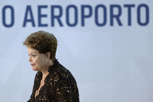 Brazil's President Dilma Rousseff looks on during the inauguration ceremony for the South Pier of the Juscelino Kubitschek International Airport in Brasilia April 16, 2014. REUTERS/Ueslei Marcelino