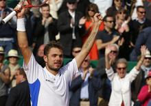 Stanislas Wawrinka of Switzerland celebrates after winning the final match against his compatriot Roger Federer at the Monte Carlo Masters in Monaco April 20, 2014. REUTERS/Eric Gaillard